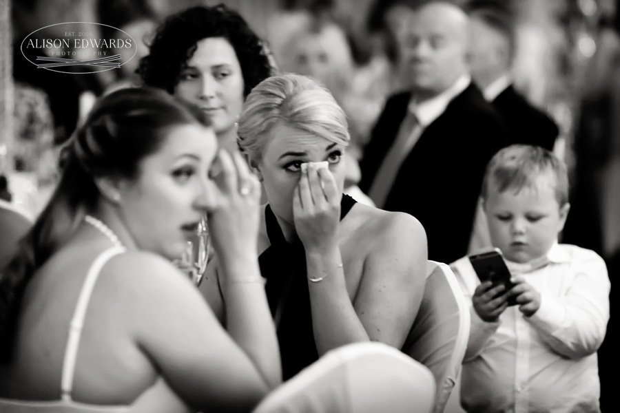 bridesmaid and guests crying during wedding speeches