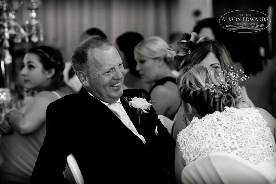 bride, mum and dad laughing during speeches at Goosedale