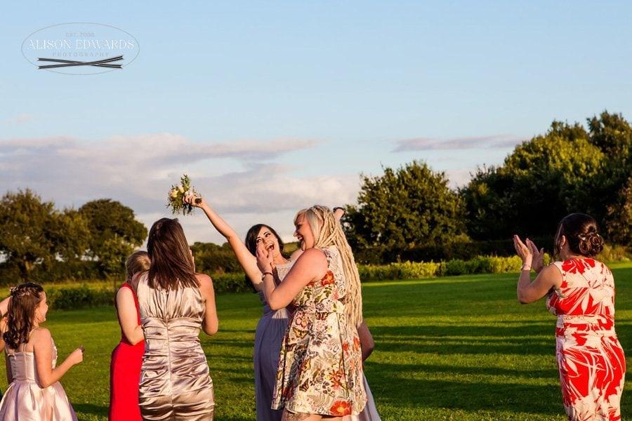 Wedding guest catching bouquet