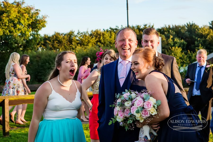 wedding guests laughing together at Goosedale