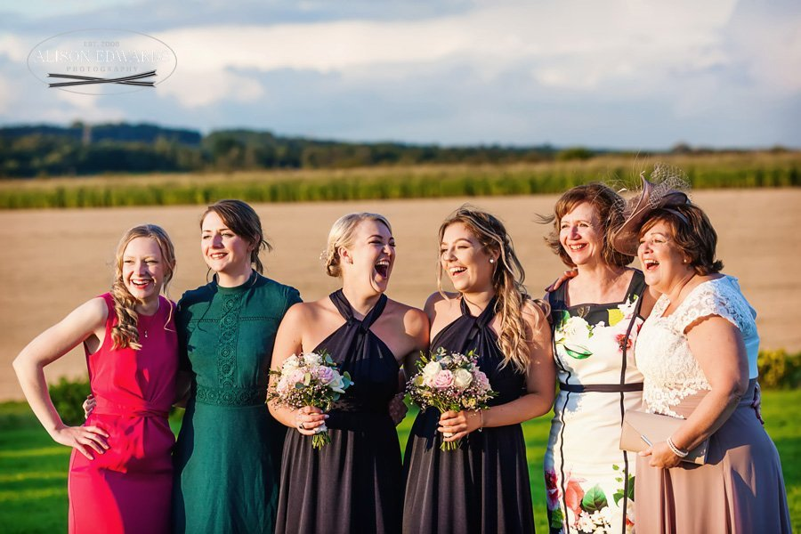 wedding guests all laughing at Goosedale