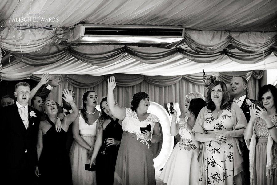 wedding guests watching bride and groom dancing