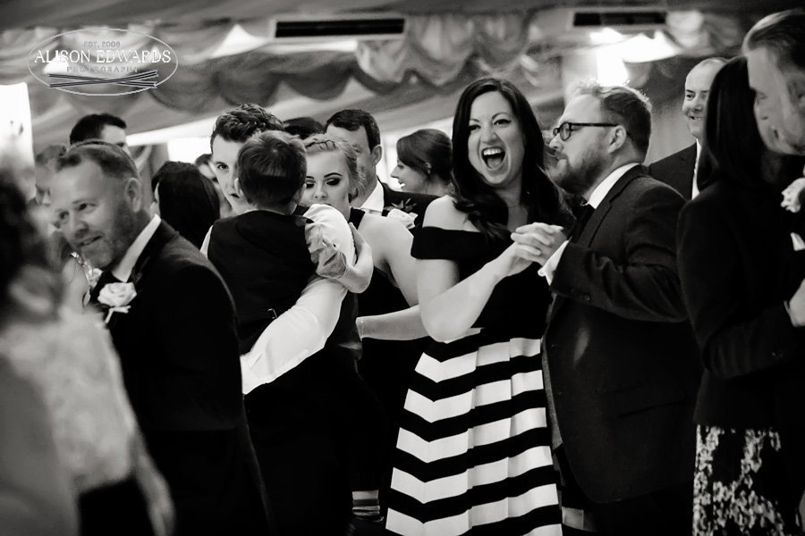 wedding guests dancing and singing
