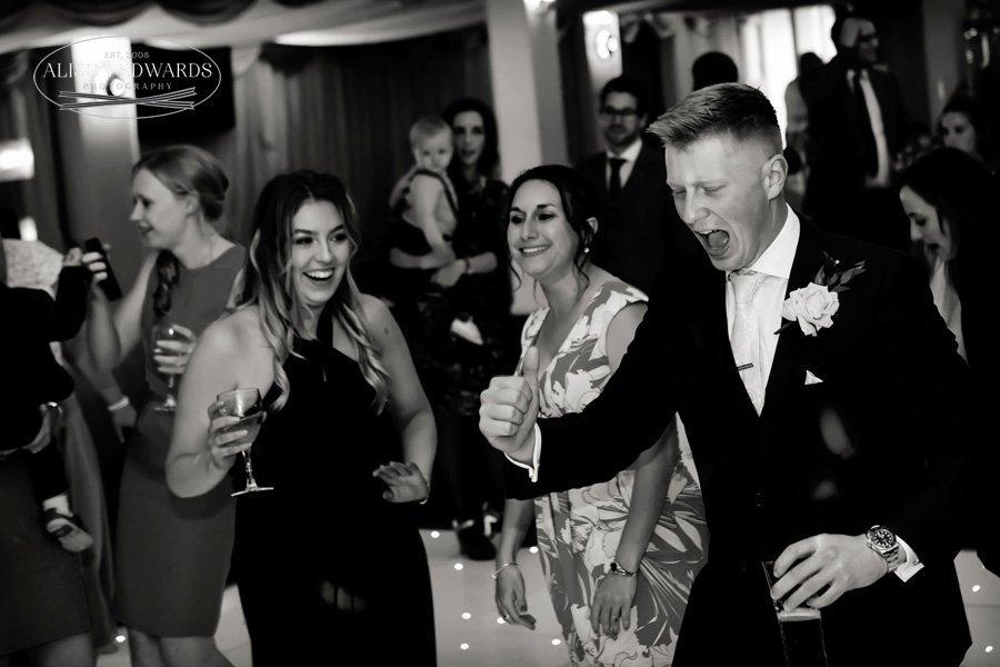 usher and bridesmaid laughing and dancing