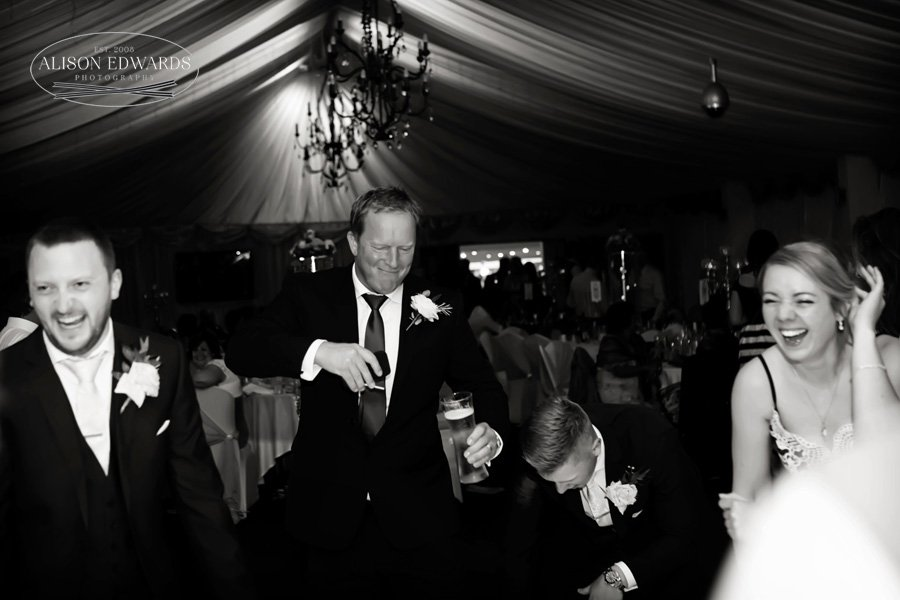 wedding guests laughing and dancing