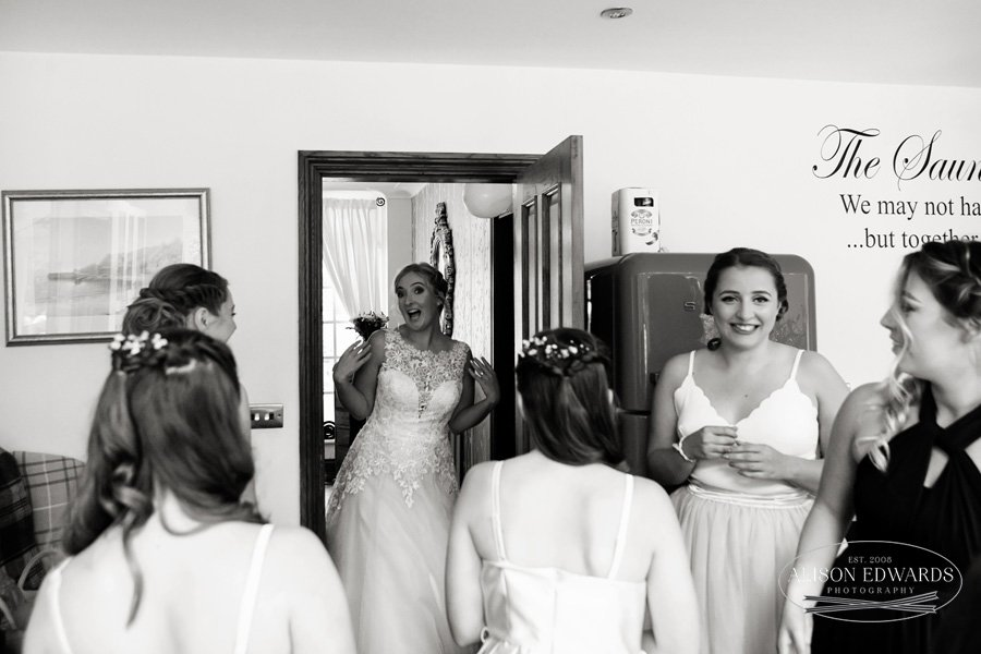 bride walking into kitchen for first glimpse of dress