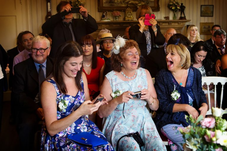 wedding guests laughing during ceremony at Allington Manor