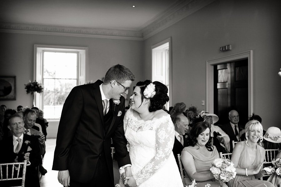 bride and groom smiling at each other after ceremony at Stubton Hall