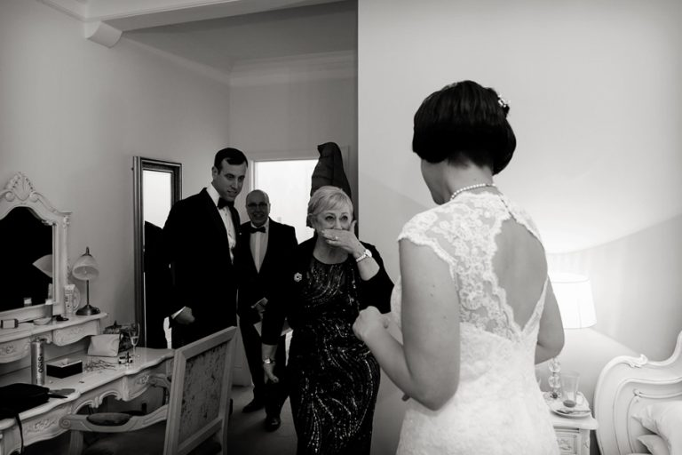 mum crying when she sees bride in her wedding dress