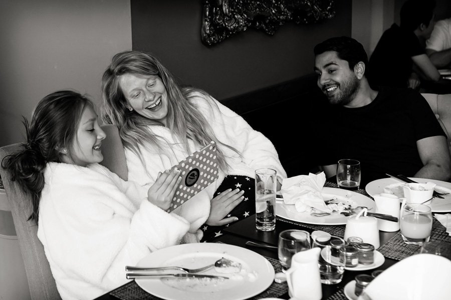 guests laughing at breakfast