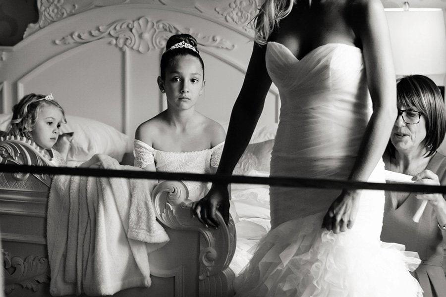 bride and bridesmaid's reflection in mirror