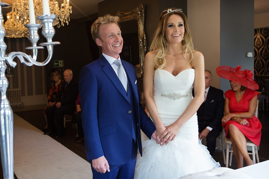 bride and groom laughing at Old Vicarage Boutique wedding ceremony