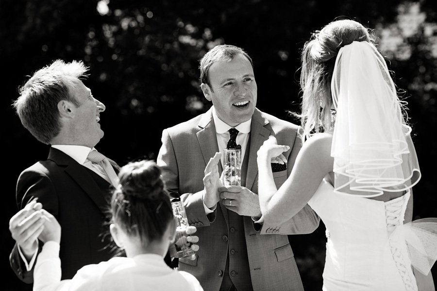 wedding guests laughing together at Old Vicarage Boutique Hotel