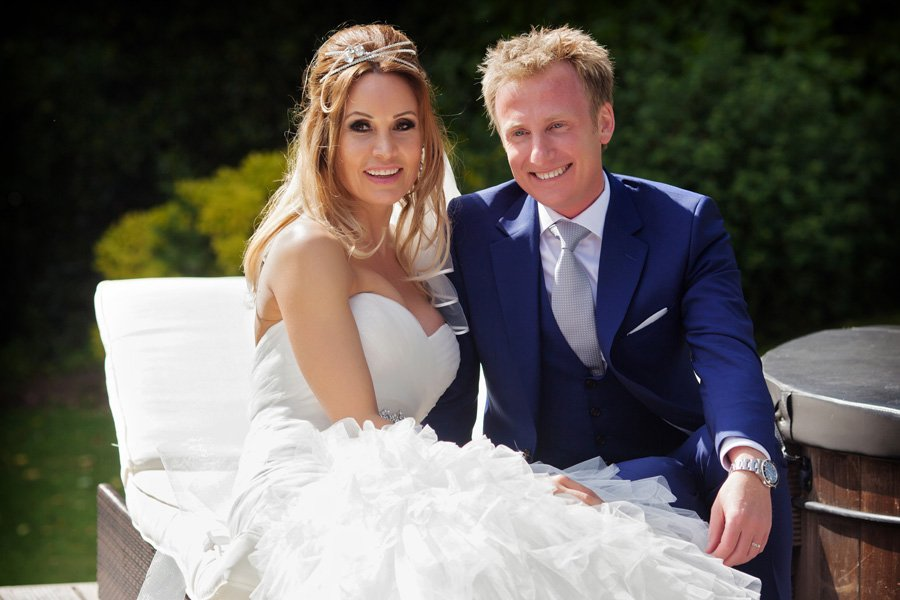 bride and groom sitting on sun loungers at Old Vicarage Boutique Hotel
