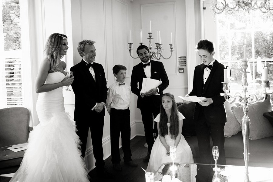 guests listing to wedding speeches