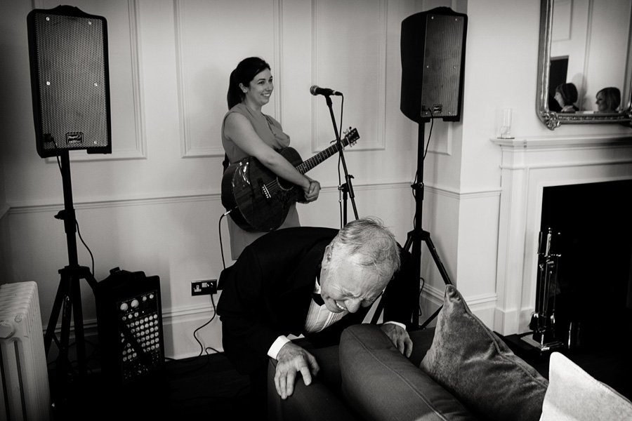 guest falling laughing during wedding speeches