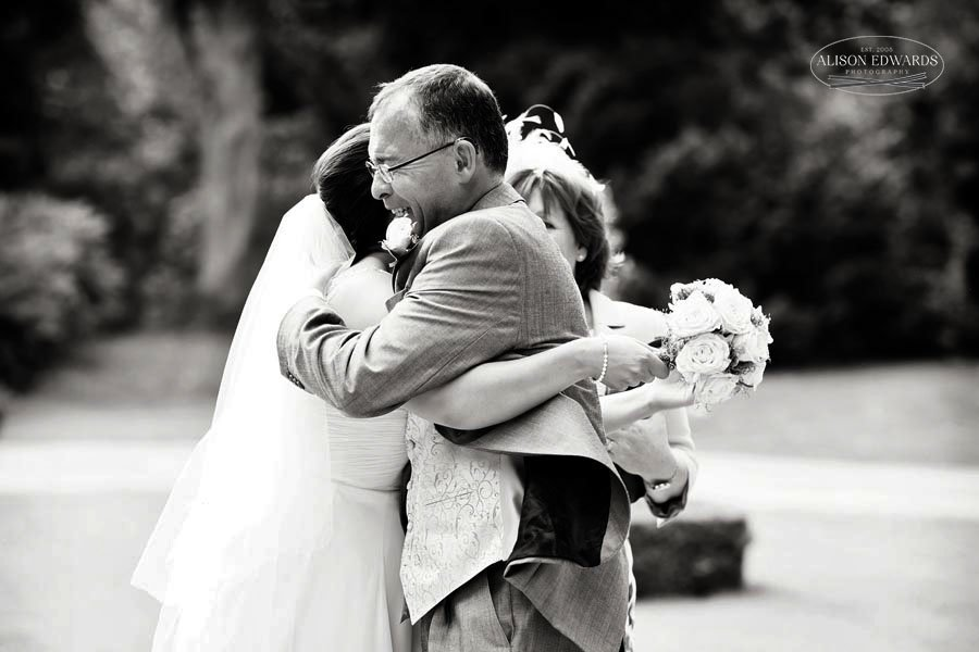 father and bride at Hambleton Hall hugging