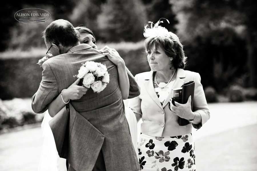 Mother father and bride at Hambleton Hall tears and hugging