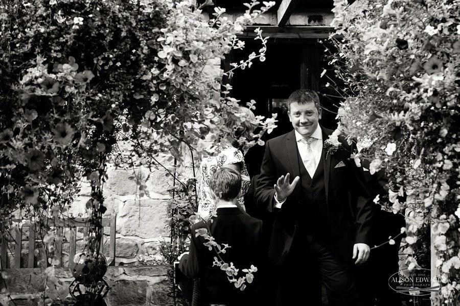 groom leaving house for church