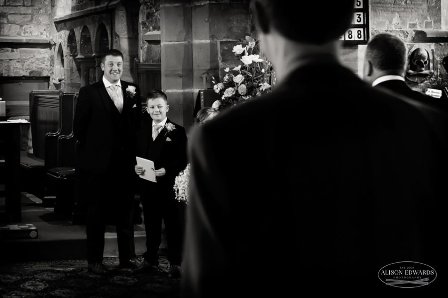 groom and son at the bottom of the aisle