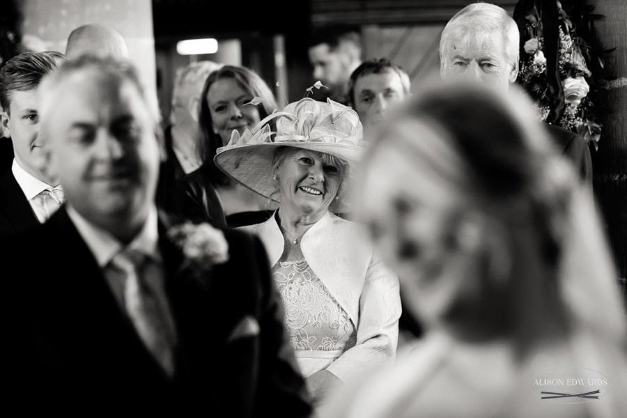 bride's mum smiling in church