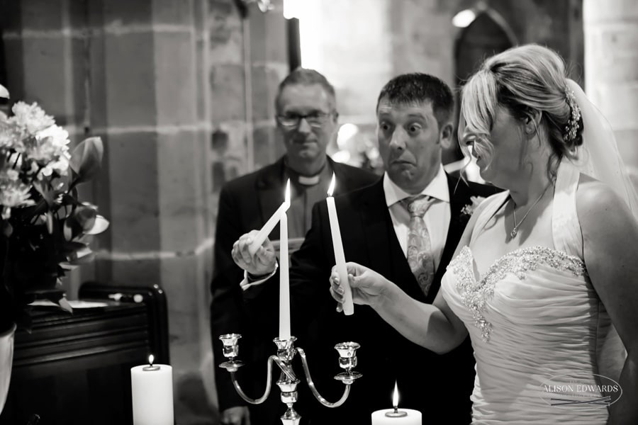 bride and groom lighting candles in weston on trent church wedding