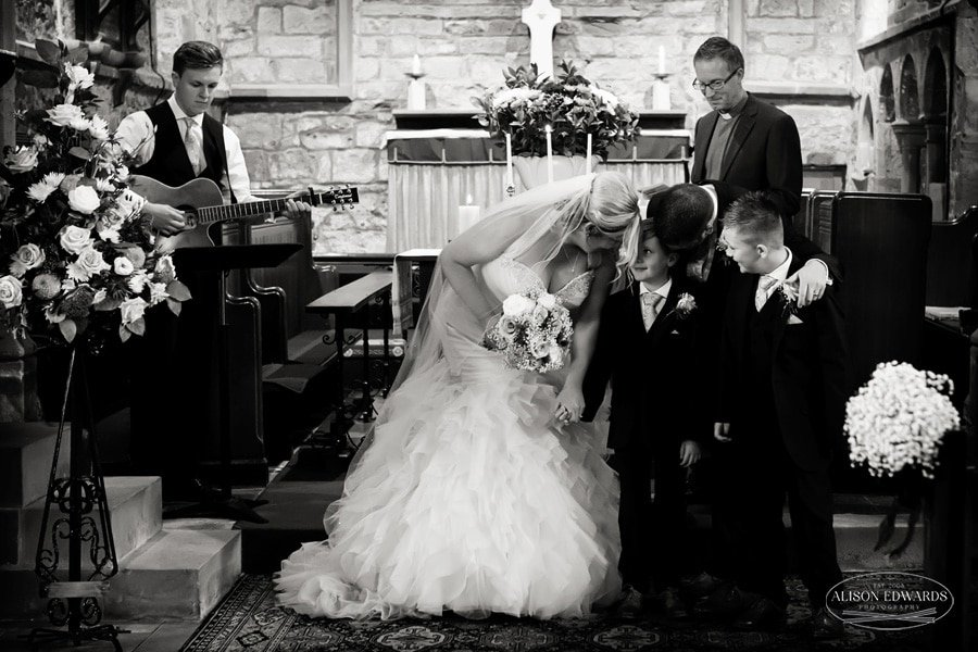 bride with sons at aisle of church