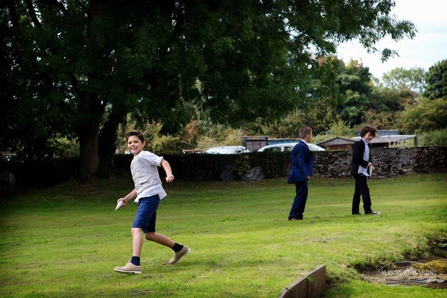 children playing outside of church wedding